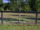 Horseman Mesh Fencing with a black top site rail